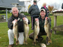 Wayne Farnsworth Jr. and Pooh Bear holding first place walleye from their Walleye Central 2008 Bragging Rights Tournament catch